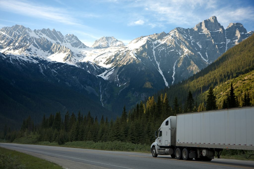 logistics-lorry-mountains-93398-1024x683