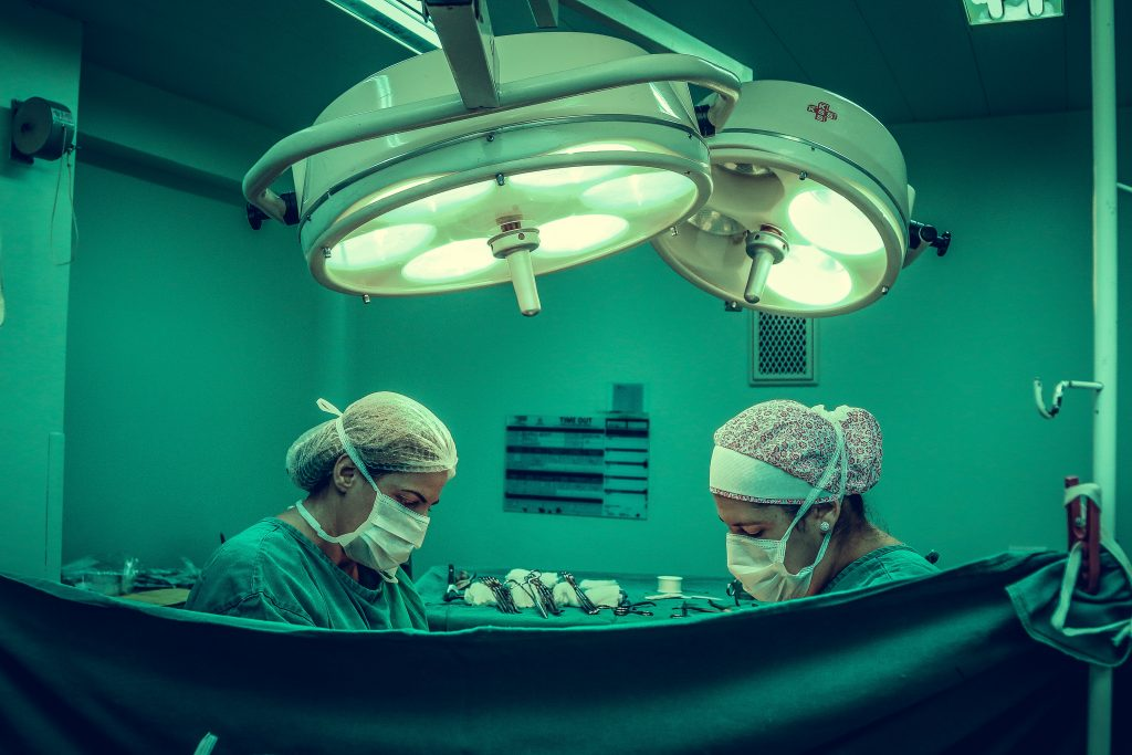 two-person-doing-surgery-inside-room-1250655-1024x683