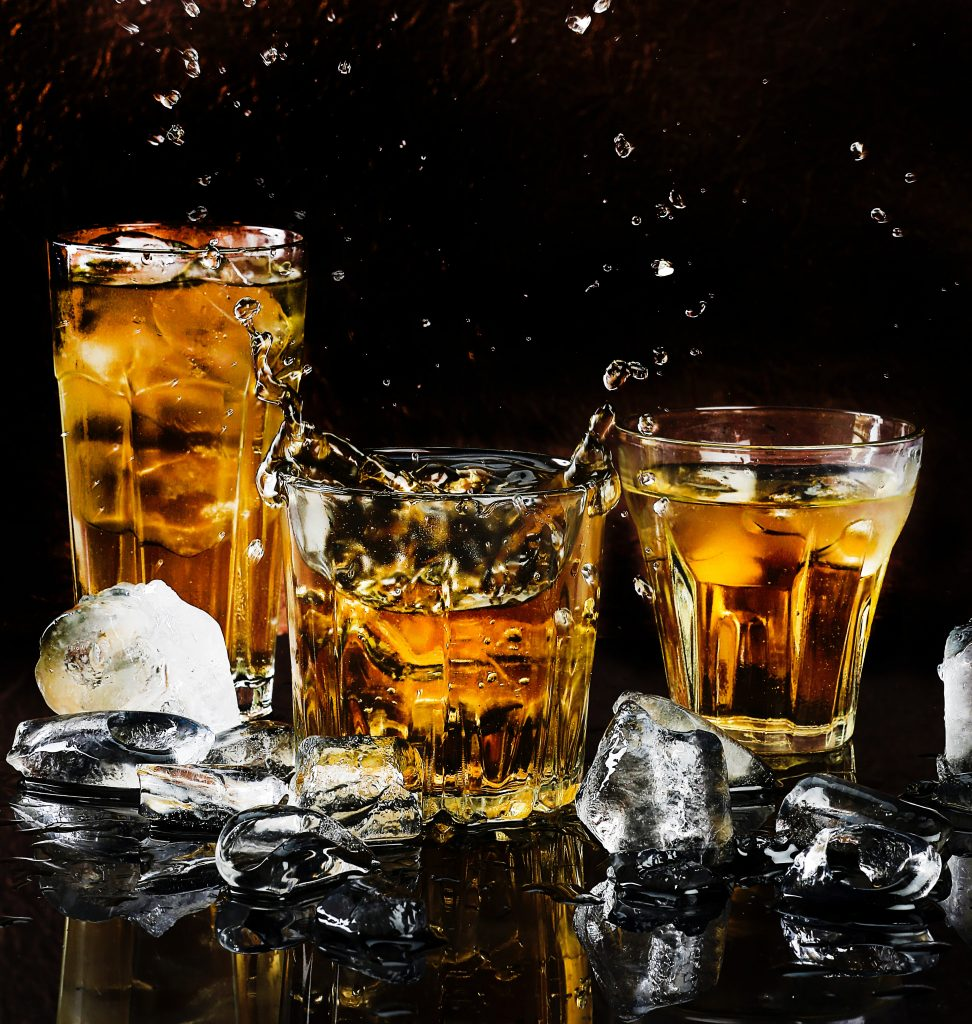 alcohol-bar-black-background-close-up-602750-972x1024