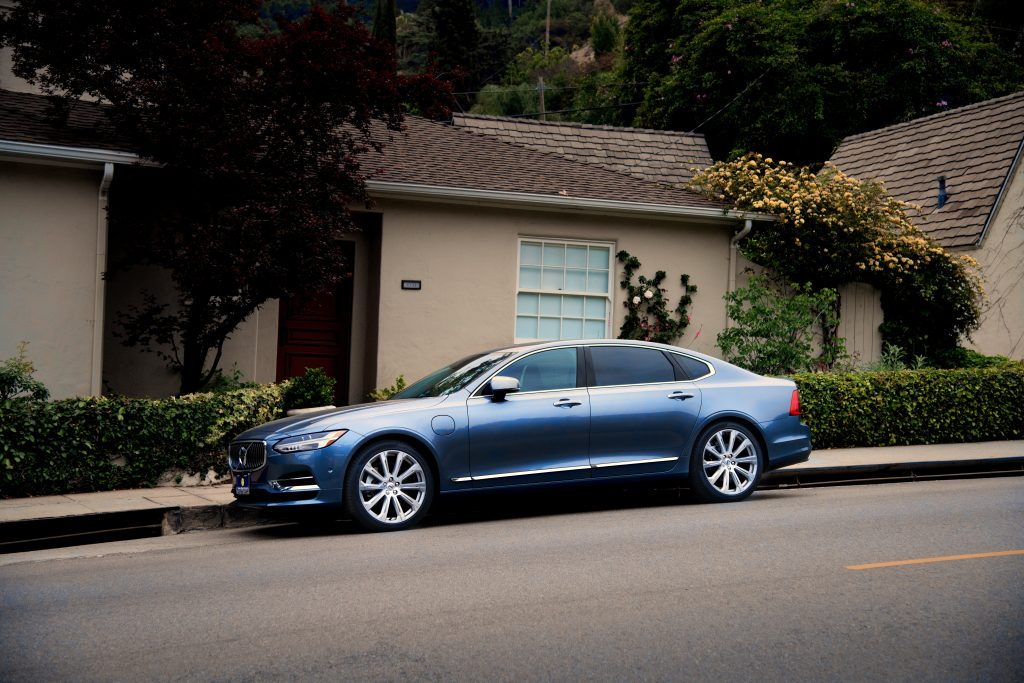 photo-of-blue-sedan-parked-on-the-side-of-the-road-1213293-1024x683