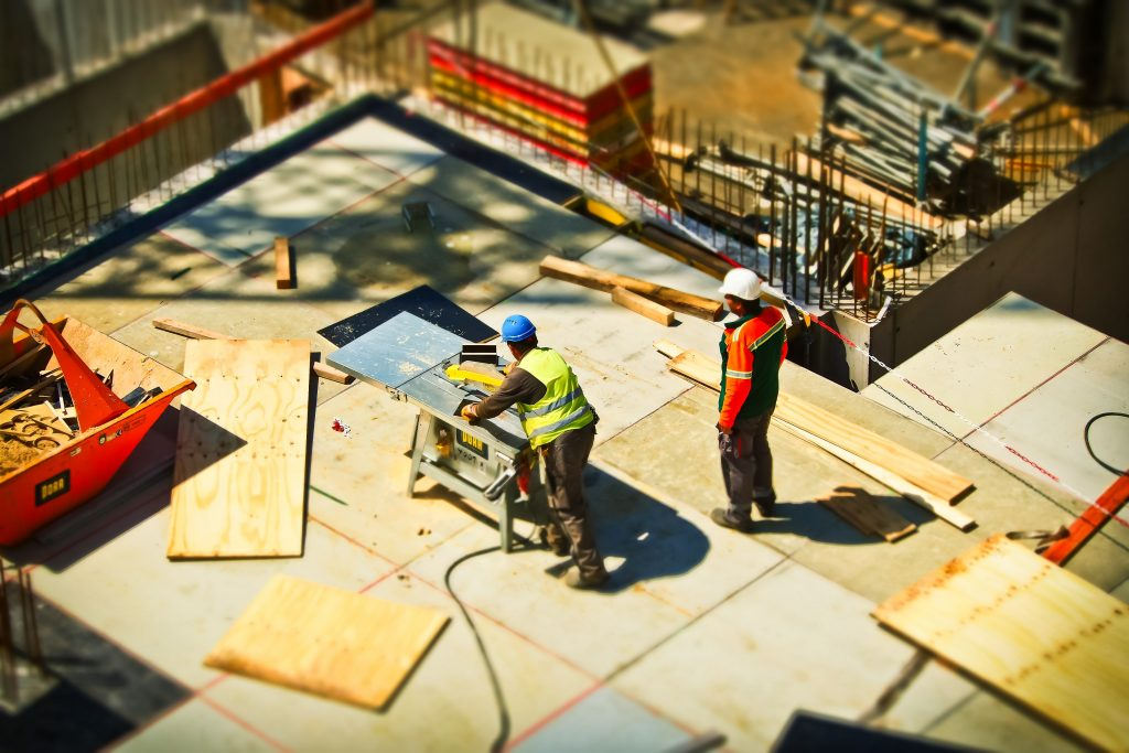 2-man-on-construction-site-during-daytime-159306-1024x683