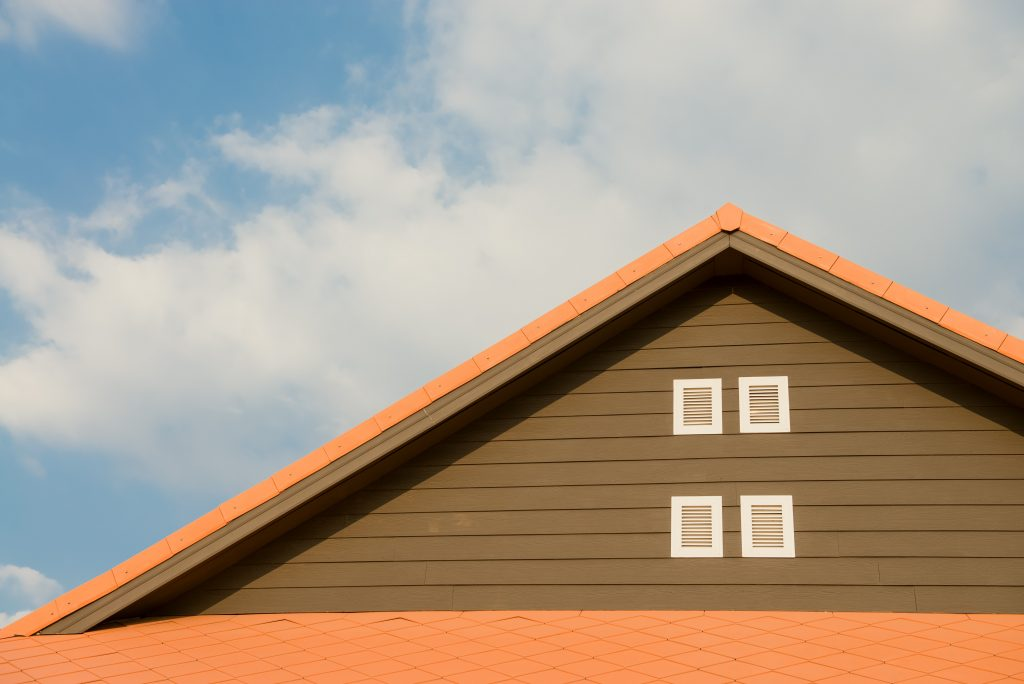orange-and-gray-painted-roof-under-cloudy-347152-1024x684