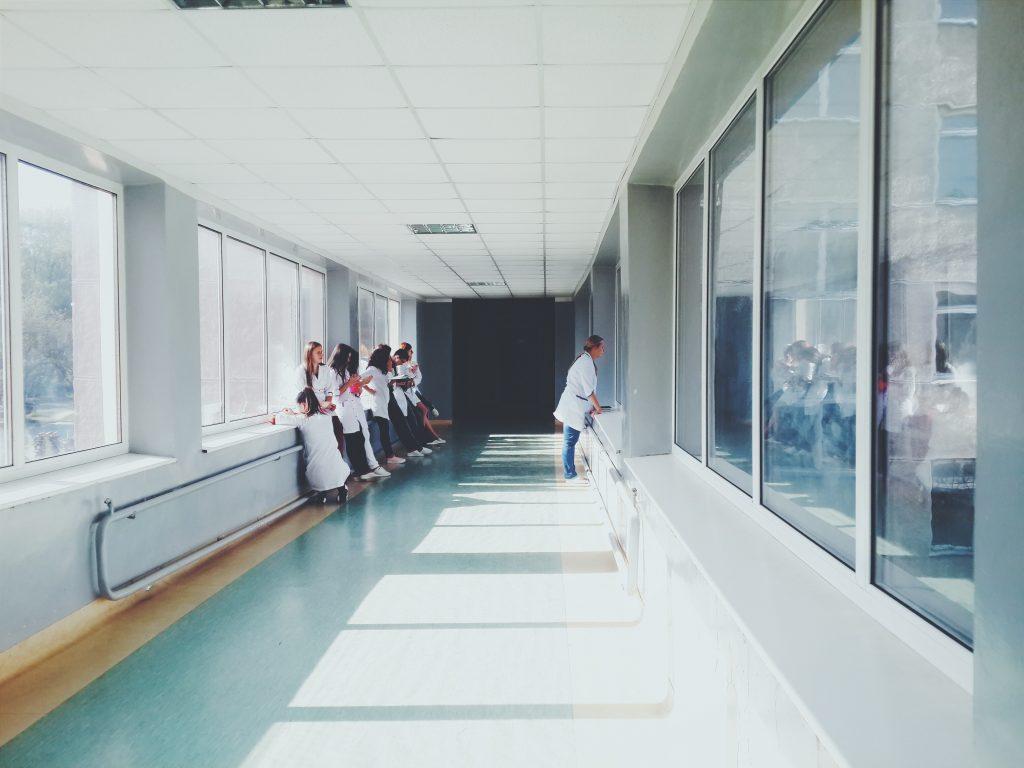 woman-in-white-shirt-standing-near-glass-window-inside-room-127873-1024x768